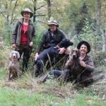 Hundeführer/innen mit ihren Hunden